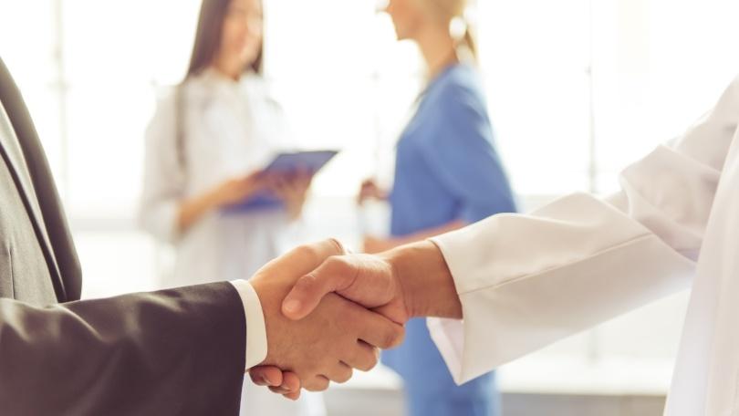 dentist and financial advisor shaking hands