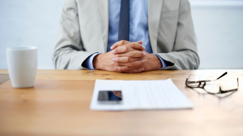 plan sponsor at table in meeting with retirement plan advisor